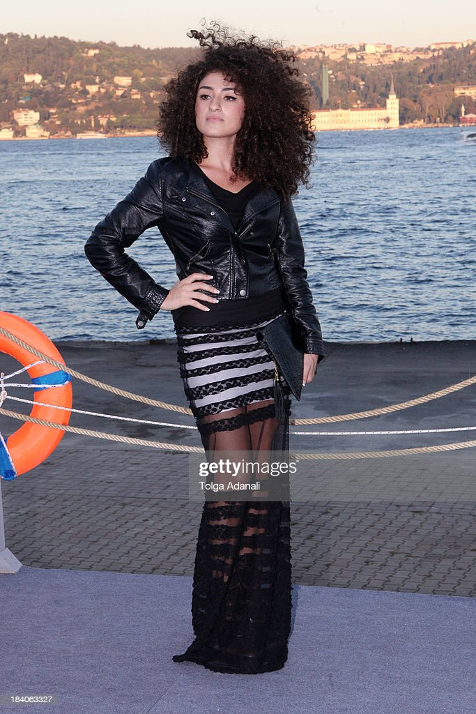The singer Dilan Citak wears a Bottega Veneta bag, a Marc Jacobs leather jacket and a turkish designer dress during Mercedes-Benz Fashion Week Istanbul s/s 2014 presented by American Express on October 11, 2013 in Istanbul, Turkey.