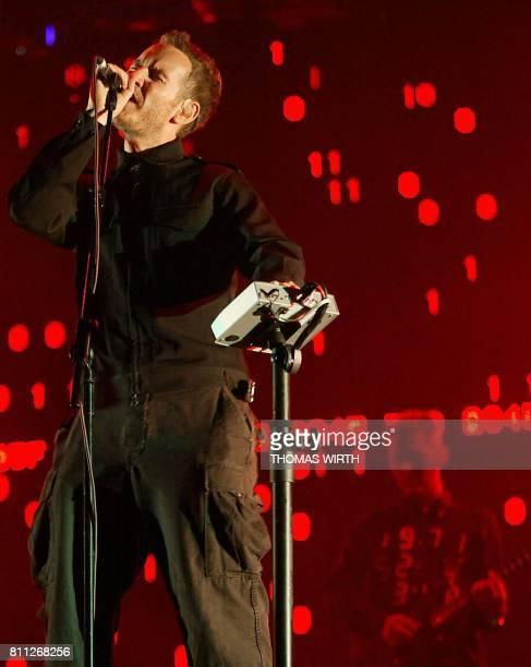 The singer from British triphop group 'Massive Attack' Robert del Naja performs on stage at the festival des Eurockéennes in Belfort 06 July 2003 AFP...
