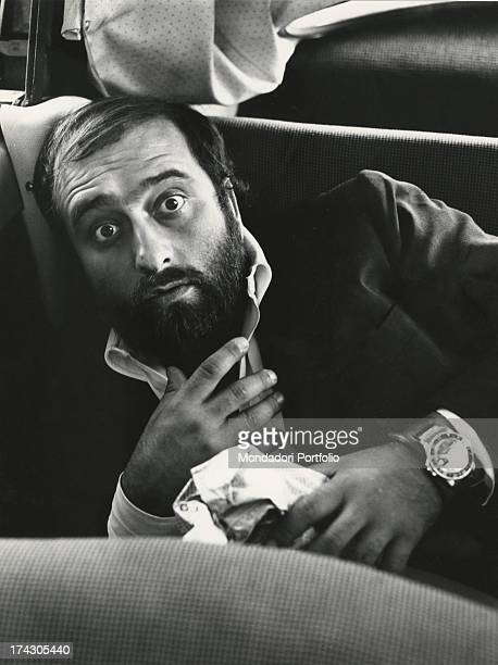 The singer Lucio Dalla is opening his eyes wide and is looking surprised 1972