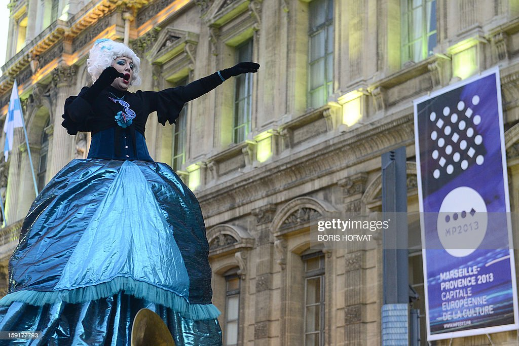 The singer of French band 'La Rumeur' performs during the presentation of a new stamp's effigy published by French postal services La Poste and displayed on the facade of the regional prefecture in Marseille, southern France, ahead of the 2013 'Marseille-Provence European Capital of Culture', starting on January 12.