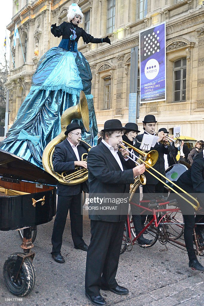 The singer of French band 'La Rumeur' performs with her musicians during the presentation of a new stamp's effigy published by French postal services La Poste and displayed on the facade of the reg...