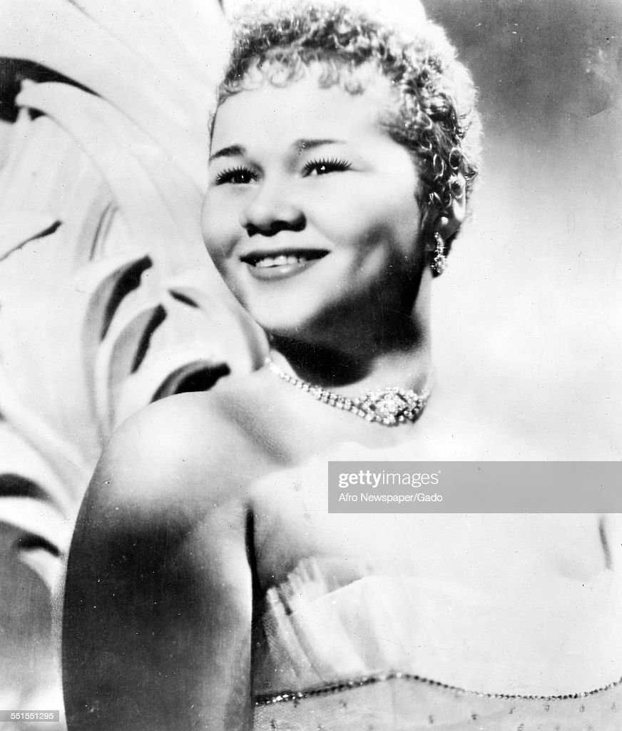 The singer songwriter <a gi-track='captionPersonalityLinkClicked' href=/galleries/search?phrase=Etta+James&family=editorial&specificpeople=833123 ng-click='$event.stopPropagation()'>Etta James</a>, on stage, smiling, 1960.