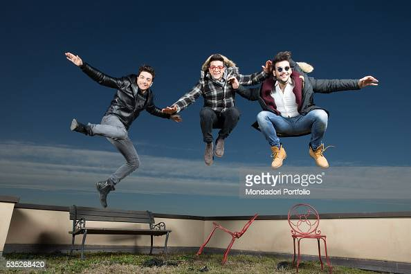 The singers and members of the band Il Volo Piero Barone Ignazio Boschetto and Gianluca Ginoble jumping up on a terrace Bologna Italy 11th January...