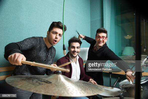 The singers and members of the band Il Volo Piero Barone Ignazio Boschetto and Gianluca Ginoble playing drums Bologna Italy 11th January 2015