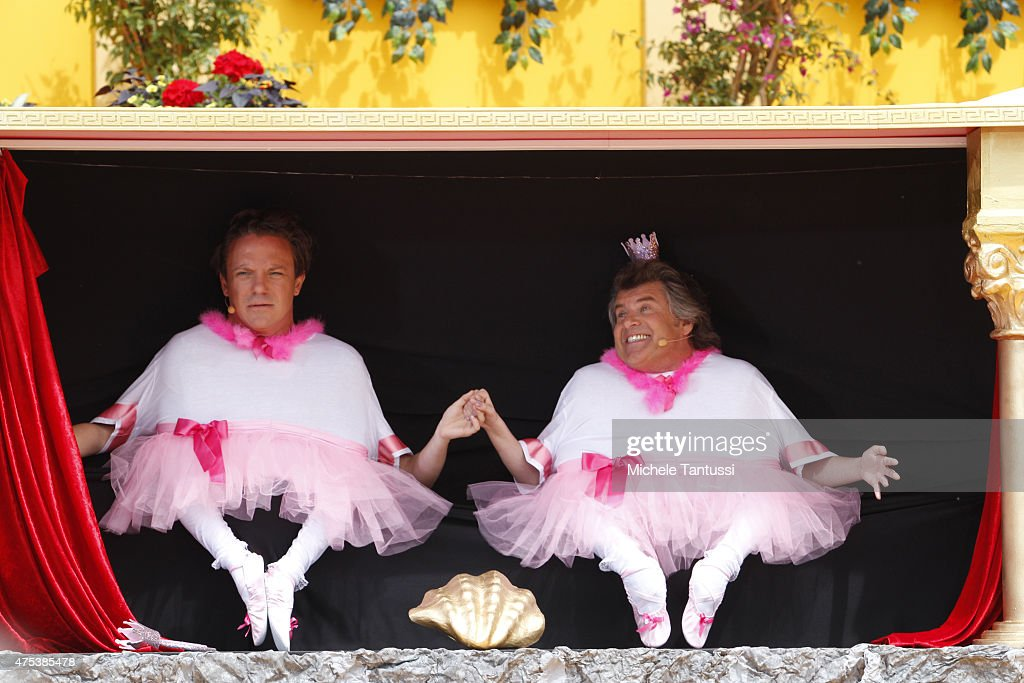 The singers Andy Borg R and Stefan Mross perform in during the season kick off of the tv show 'Immer wieder Sonntags' at Europapark on May 31 2015 in...