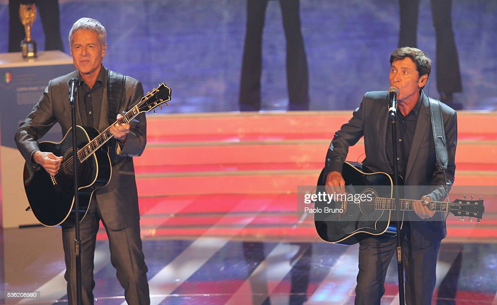 The singers Claudio Baglioni and <a gi-track='captionPersonalityLinkClicked' href=/galleries/search?phrase=Gianni+Morandi&family=editorial&specificpeople=2364530 ng-click='$event.stopPropagation()'>Gianni Morandi</a> perform during the 'Sogno Azzurro' TV programme at Auditorium del Foro Italico on May 31, 2016 in Rome, Italy.
