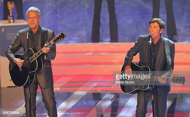 The singers Claudio Baglioni and Gianni Morandi perform during the 'Sogno Azzurro' TV programme at Auditorium del Foro Italico on May 31 2016 in Rome...