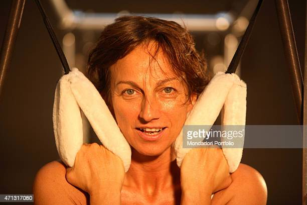 The singersongwriter and musician Gianna Nannini being photo shooted during her pilates training at the gym The Art of Pilates on via Bellezza Milan...