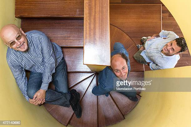 'The singersongwriter Enrico Ruggeri and the comedians Ale and Franz posing together on a spiral staircase Italy 16th July 2014 '