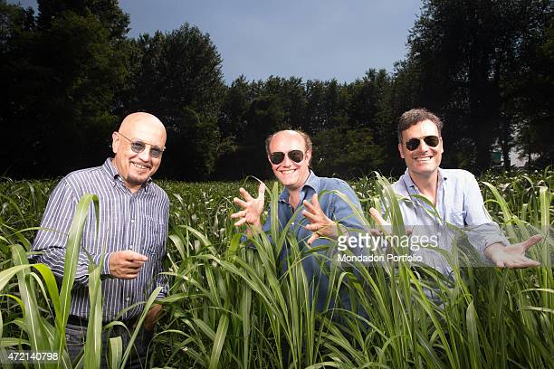 'The singersongwriter Enrico Ruggeri and the comedians Ale and Franz posing together in the grass Italy 16th July 2014 '