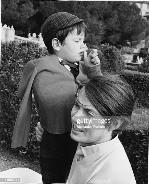 The singersongwriter Fabrizio De AndrT hugging his son Cristiano Genoa 1968