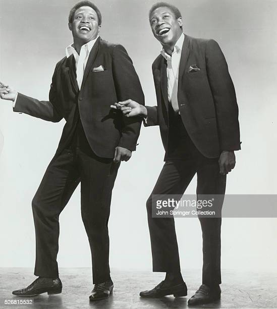 The singing duo Sam and Dave Sam Moore and Dave Prater Jr snap their fingers as they sing together