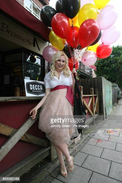 The singing waitress Victoria Hart poses outside the Naked Turtle restaurant in Richmond west London before signing a record deal with Universal...