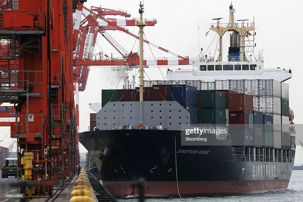 The Sinotrans Ningbo container ship sails out of a shipping terminal in Tokyo, Japan, on Tuesday, Dec. 18, 2012. Japan's exports fell for a sixth month in November and the trade deficit swelled, underscoring the challenge that incoming Prime Minister Shinzo Abe faces in reviving growth. Photographer: Kiyoshi Ota/Bloomberg via Getty Images