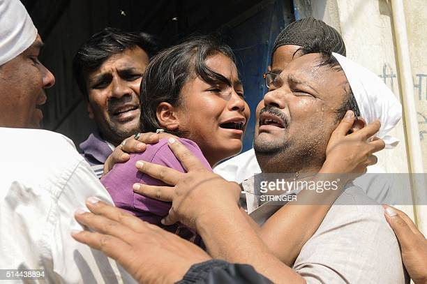The sister of an Indian girl who was raped and set on fire cries out during the funeral in Greater Noida near the Indian capital New Delhi on March 9...