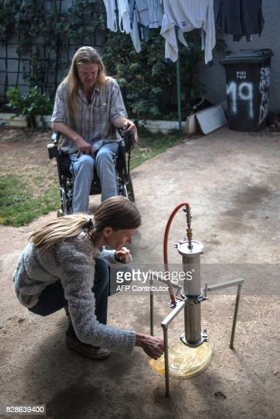 The sister of Gerd Bader affected by Multiple Sclerosis and who manufactures concentrated cannabis oil shows the process of producing oil from dried...