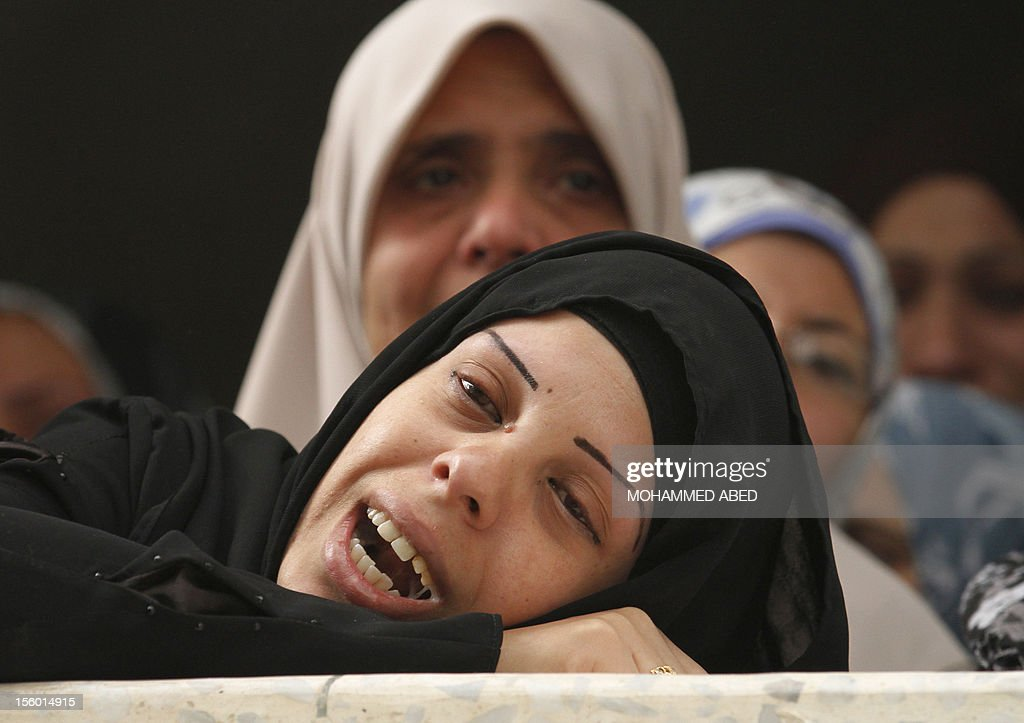 The sister of killed Palestinian civilian Ahmad Dardasawy, 18, grieves at her home during his funeral in Gaza City on November 11, 2012 , the day after he was killed in Israeli shelling as clashes erupted along the Isreali-Gaza Strip border. The flare-up was one of the most serious since Israel's devastating 22-day operation in the Gaza Strip over New Year 2009.