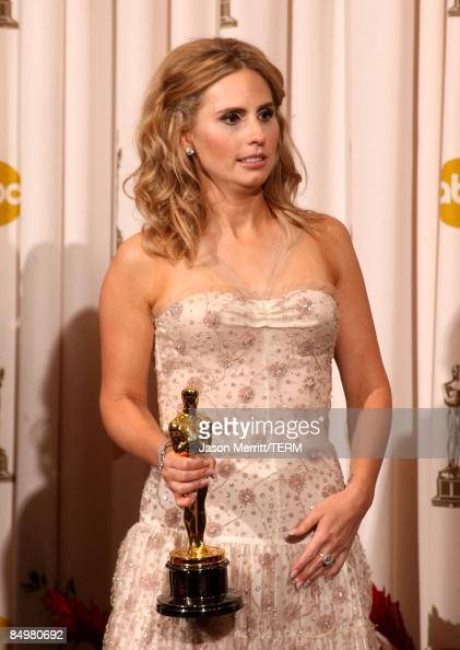 The sister of late actor Heath Ledger Kate Ledger poses in the press room after accepting the award for Best Supporting Actor for 'The Dark Night' at...