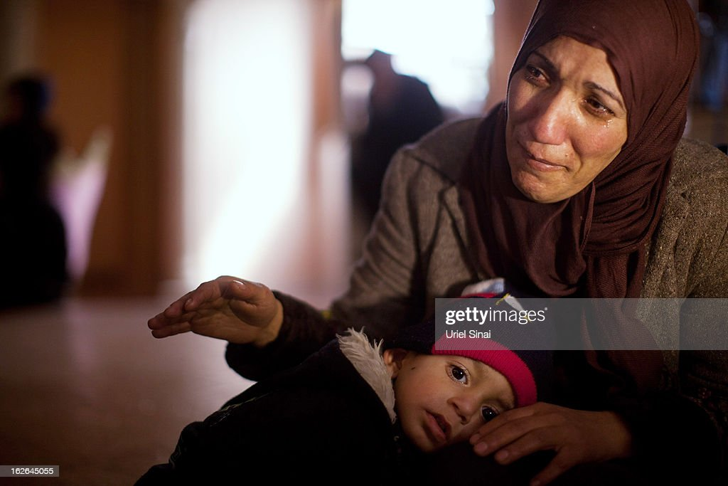 The sister of of Arafat Jaradat mourns, while holding his son Muhannad, during his funeral on February 25, 2013 in the village of Saair in the West Bank. According to reports, Jaradat died while in Israeli custody under disputed circumstances, with Palestinian officials saying an autopsy showed he was tortured.