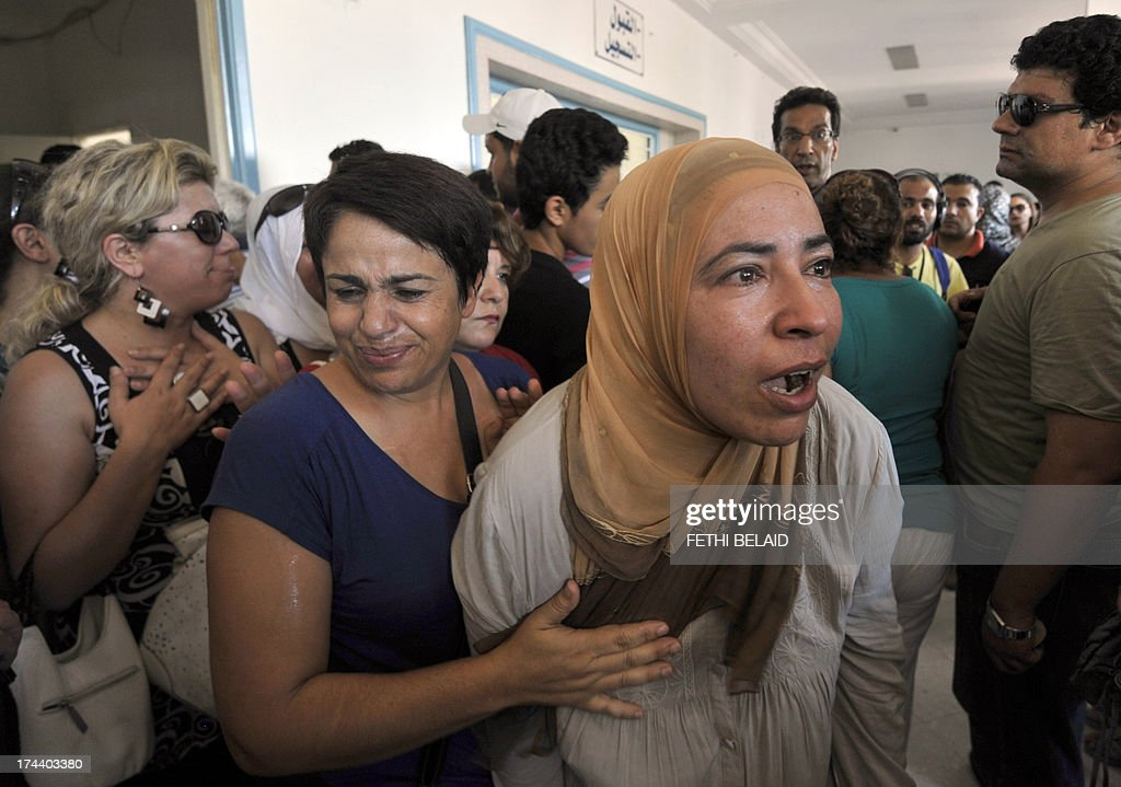 The sister of opposition politician Mohamed Brahmi, mourns at the hospital in Ariana, outside Tunis, after he was gunned down in front of his home, near the capital, on July 25, 2013. 'Mohamed Brahmi, general coordinator of the Popular Movement and member of the National Constituent Assembly, was shot dead outside his home in Ariana,' Watanya state television and the official TAP news agency reported. AFP PHOTO / FETHI BELAID