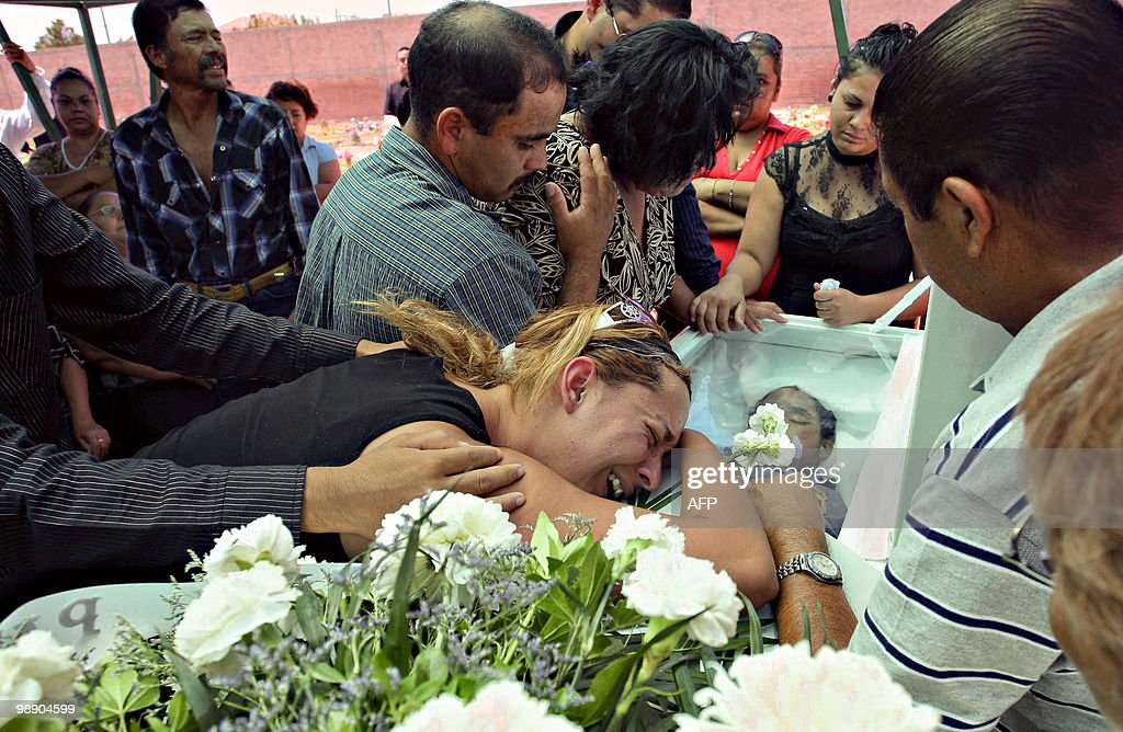 The sister of policewoman Elizabeth Paz cries over her coffin during her funeral on August 29 2009 in Ciudad Juarez Mexico Elizabeth Paz who...