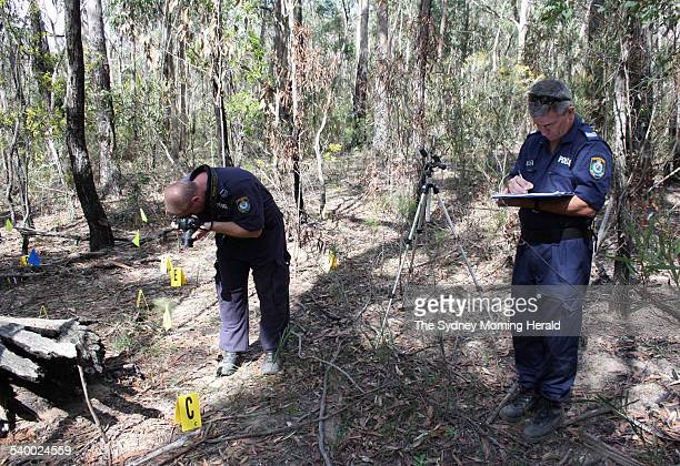 The site at Belanglo State Forest where a rider found the human remains Above detectives at the scene Below Ivan Milat Main picture by Adam McLean...
