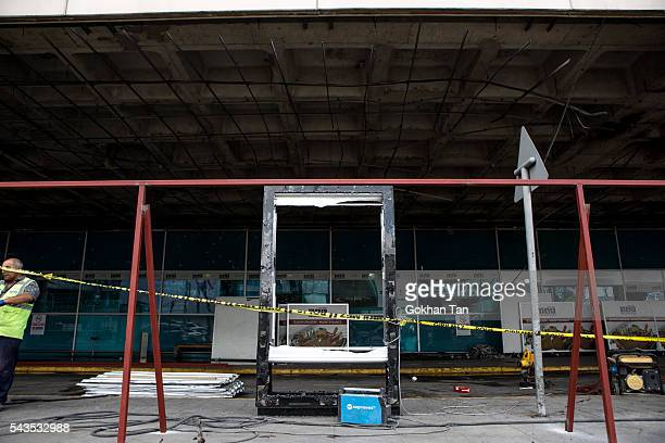 The site of the blast is closed for access at the country's largest airport Istanbul Ataturk on June 29 2016 in Istanbul Turkey Three suicide bombers...