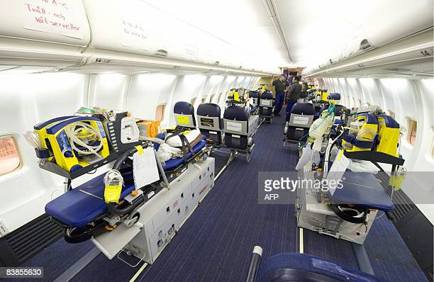 The six intensive care units from the SNAM are pictured mounted inside an SAS Boeing 737800 passenger jet converted into an advanced ambulance...