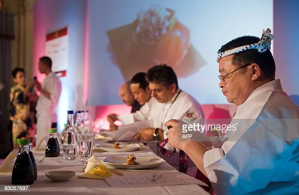 The six judges including global sushi ambassador Masayoshi Kazato taste the first entrant's dish at the 'Seven Sushi Samurai' Sushi of the Year...