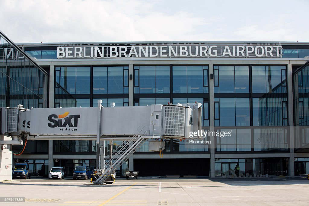 The Sixt SE logo sits on a passenger walkway outside Berlin Brandenburg International Willy Brandt Airport in Schoenefeld, Germany, on Monday, May 3, 2016. The massively overbudget airport was planned to open in 2010 and handle 27 million passengers a year, crowning Berlin as the continent's 21st century crossroads. Photographer: Krisztian Bocsi/Bloomberg via Getty Images