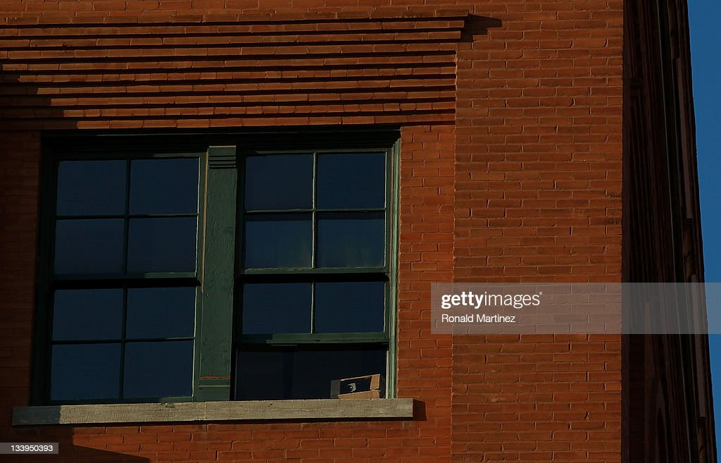 The sixth floor window of the former Texas School Book Depository, now the Dallas County Administration Building on the 48th anniversary of JFK's assassination in Dealey Plaza on November 22, 2011 in Dallas, Texas. The 48th anniversary of the assassination of U.S. President John F. Kennedy as he rode in a Presidential motorcade in Dealey Plaza, will be marked on November 22.