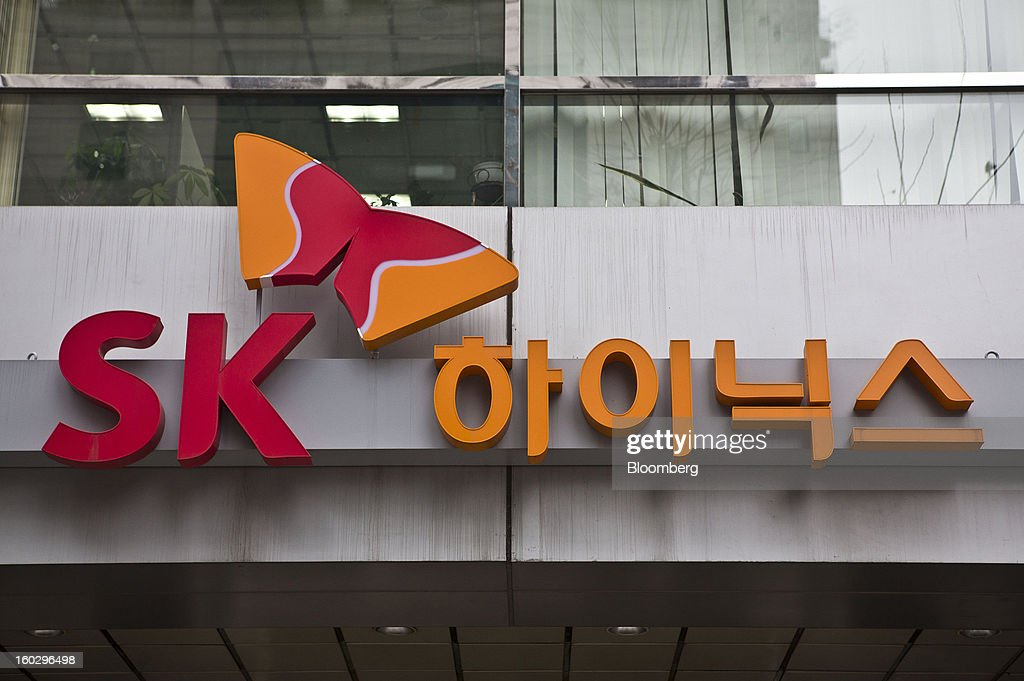 The SK Hynix Inc. logo is displayed above the entrance to the company's headquarters in Seoul, South Korea, on Monday, Jan. 28, 2013. Hynix is scheduled to release full-year earnings on Jan. 30. Photographer: Jean Chung/Bloomberg via Getty Images