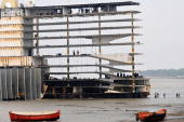 The skeletal remains of a ship is seen at a shipbreaking yard in Shitakundo some 16 kms from Chittagong on April 19 2009 A cyclone packing winds of...