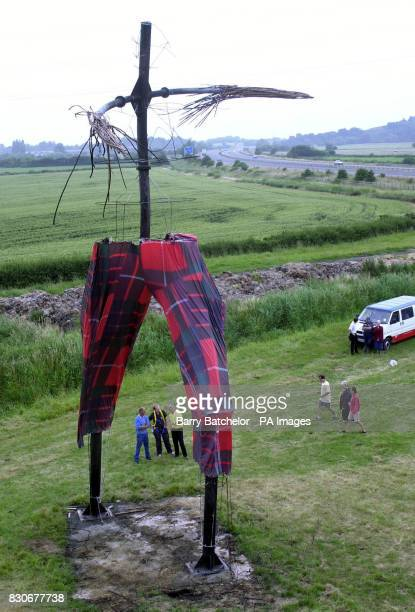 The skeleton of the giant sculpture 'Willow Man' wearing his tartan 'Wrong Trousers' for Wallace Gromit's Wrong Trousers Day alongside the M5...
