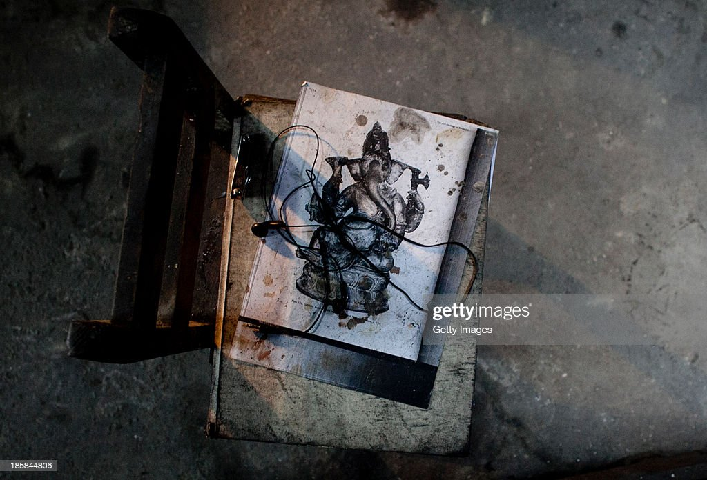 The sketch of a sculpture is seen at Dhamrai Metal Crafts on October 25, 2013 in Dhaka, Bangladesh. The owner of the metal crafts shop, Sukanta Banik, creates bronze sculptures in the art of 'lost wax casting.' The business has been in his family for 200 years. The pieces are first molded in wax, then encased in clay, then baked in the oven, after which metal is poured into the mold. One piece can take up to 10 months to make. The business is suffering because most of these items he creates can now be mass produced in plastic, and as a Hindu artist working in Islamic Bangladesh, the 'depiction of all humans and animals are discouraged by the majority religion.' Recently it took a year and a half to send an order overseas, when Bangladeshi customs held his work in hopes for a bribe.