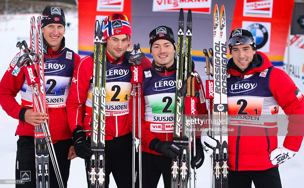 The skiers of the winner team Norway I, <a gi-track='captionPersonalityLinkClicked' href=/galleries/search?phrase=Lars+Berger&family=editorial&specificpeople=802043 ng-click='$event.stopPropagation()'>Lars Berger</a>, <a gi-track='captionPersonalityLinkClicked' href=/galleries/search?phrase=Petter+Northug&family=editorial&specificpeople=800847 ng-click='$event.stopPropagation()'>Petter Northug</a>, Finn Haagen Krogh and <a gi-track='captionPersonalityLinkClicked' href=/galleries/search?phrase=Eldar+Roenning&family=editorial&specificpeople=802581 ng-click='$event.stopPropagation()'>Eldar Roenning</a> (L-R) pose after the victory ceremony in the men's 4x10km Cross Country Skiing Relay during the FIS World Cup on November 20, 2011, in Sjusjoen, Norway.