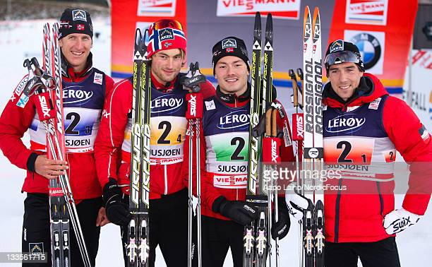 The skiers of the winner team Norway I Lars Berger Petter Northug Finn Haagen Krogh and Eldar Roenning pose after the victory ceremony in the men's...