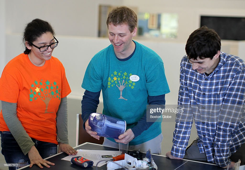 The Skills for Living Center teaches social skills to children and young adults. Instructor Rob Shamitz, center, leads Brianna Callanan, left, and Adam Koropey, right in a science and engineering workshop.