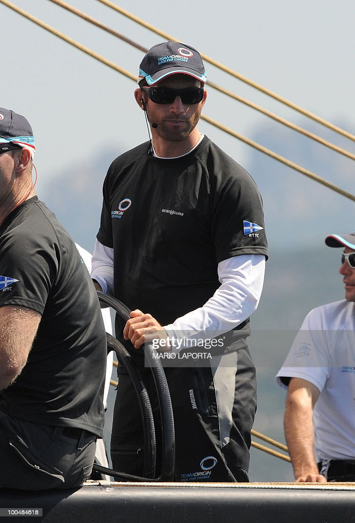 The skipper of British teamOrigin Ben Ainslie gets ready before a match race regatta against Kiwi team Emirates New Zealand of the Louis Vuitton Trophy on May 24, 2010 at La Maddalena island in Sardinia. 10 teams battle it out over a two-week regatta begun on May 22 until June 6, 2010.