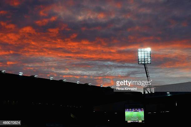 The sky lights up red as the sun sets over Vicarage Road during the Barclays Premier League match between Watford and Arsenal at Vicarage Road on...