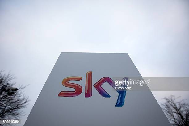 The 'Sky' logo sits on a sign outside Sky Plc headquarters in Isleworth London UK on Thursday Dec 15 2016 21st Century Fox Inc may announce a formal...