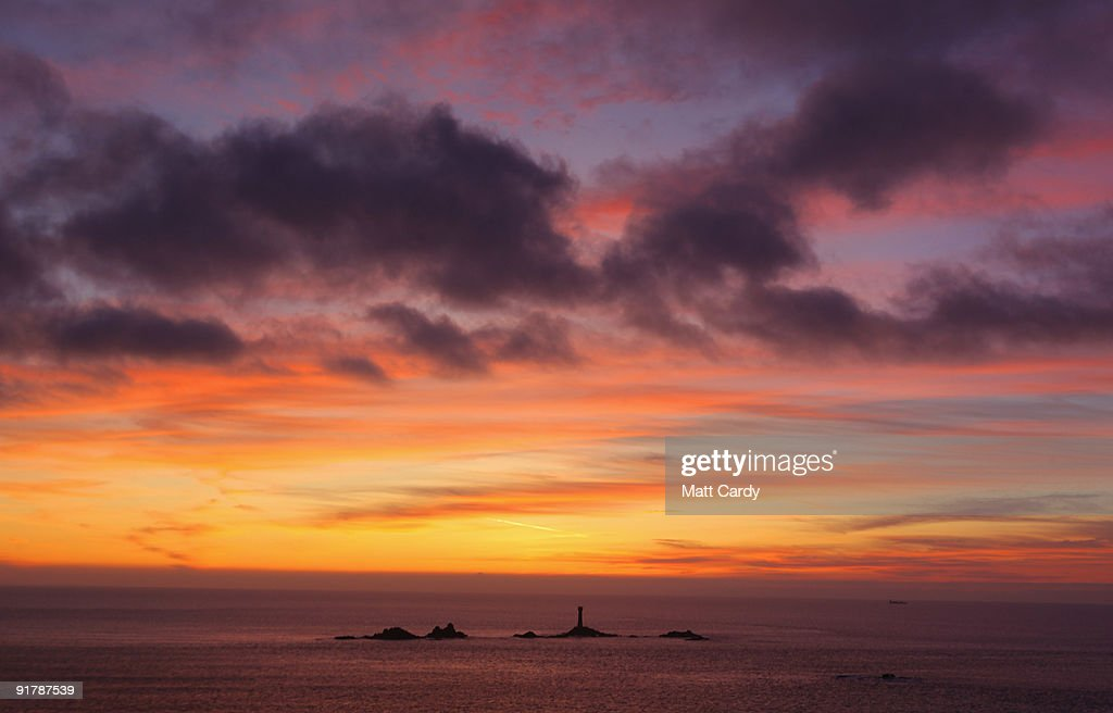 The sky over Lands End darkens after the sun has set October 10, 2009 in Cornwall, England. England, particularly in the south, is currently enjoying a spell of dry, fine weather, allowing the begining of the Autumn foliage colours - brought on by shortening daylight hours and cooler weather - to be fully appreciated.
