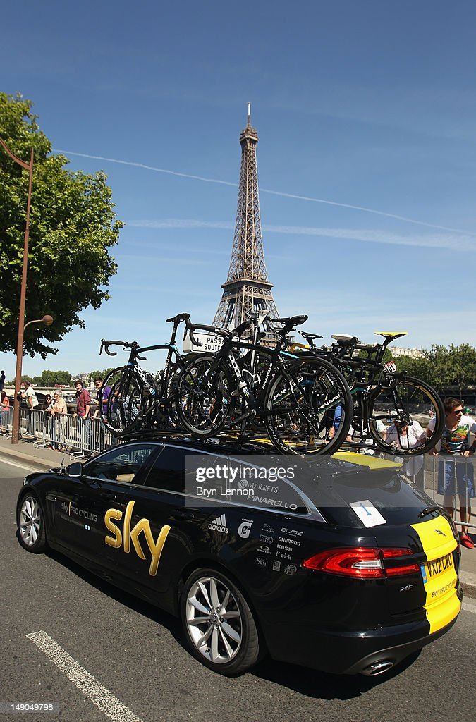 The SKY Procycling team Jaguar car passes the Eiffel Tower decked out in yellow livery to celebrate Bradley Wiggins winning the 2012 Tour de France during the twentieth and final stage of the 2012 Tour de France, from Rambouillet to the Champs-Elysees on July 22, 2012 in Paris, France.