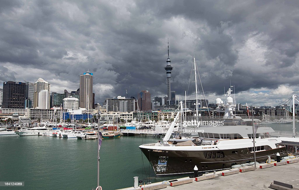 The Sky Tower, center, stands in the central business district behind boats moored at the Viaduct Basin in Auckland, New Zealand, on Wednesday, March 20, 2013. The New Zealand dollar, nicknamed the kiwi, fell against most major peers as the government said the country's most widespread drought in at least 30 years reduces pressure to raise interest rates. Photographer: Brendon O'Hagan/Bloomberg via Getty Images
