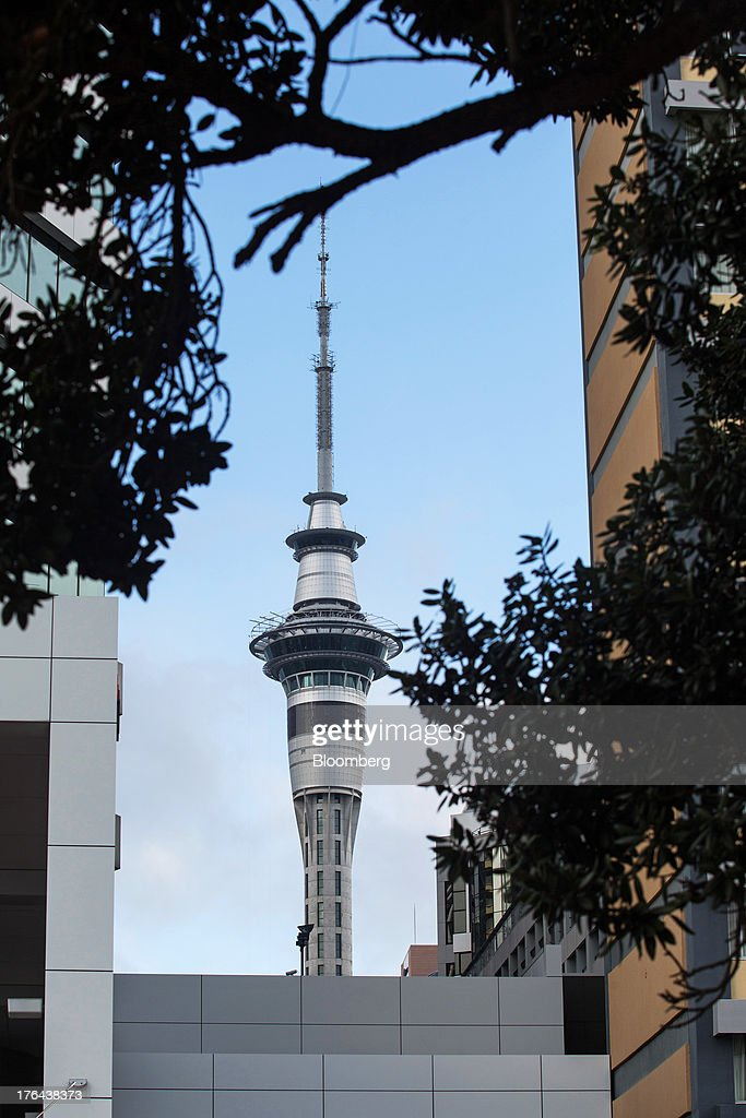 The Sky Tower is seen between buildings in the central business district in Auckland, New Zealand, on Monday, Aug. 12, 2013. New Zealand's growth rate is forecast to outpace Australia's for the next two years, helping stem an exodus that's resulted in the highest proportion of its people living overseas in the developed world after Ireland. Photographer: Brendon O'Hagan/Bloomberg via Getty Images