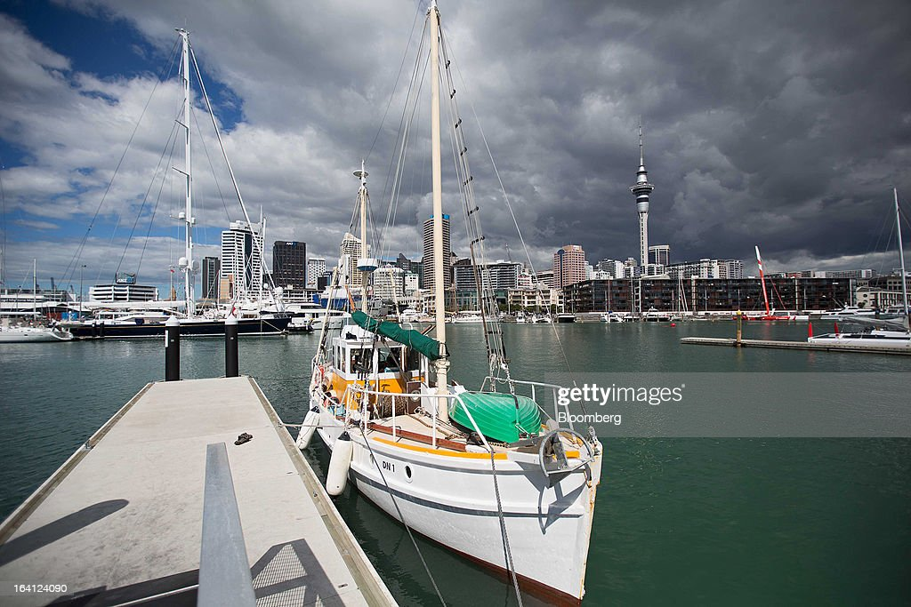 The Sky Tower, right, stands in the central business district behind boats moored at the Viaduct Basin in Auckland, New Zealand, on Wednesday, March 20, 2013. The New Zealand dollar, nicknamed the kiwi, fell against most major peers as the government said the country's most widespread drought in at least 30 years reduces pressure to raise interest rates. Photographer: Brendon O'Hagan/Bloomberg via Getty Images