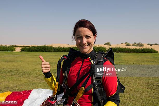 The skydiving girl happy after a save landing