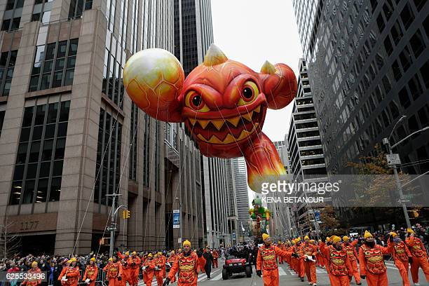 The Skylander balloon flies over Sixth avenue during the 90th annual Macy's Thanksgiving Day Parade on November 24 2016 in New York / AFP / KENA...