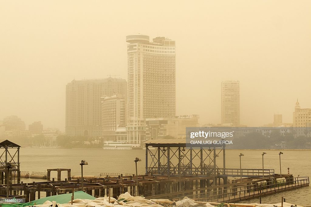 The skyline of Cairo is seen on May 13, 2013 as a sandstorm sweeps through the Egyptian capital. AFP PHOTO/GIANLUIGI GUERCIA