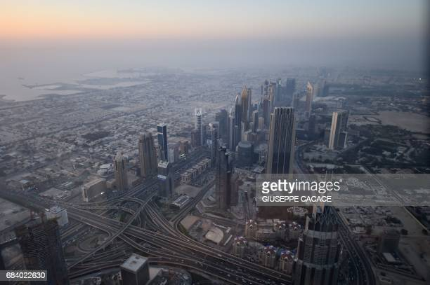 The skyline of Dubai is pictured from the Burj Khalifa the tallest building in the world standing at 828 metres on May 16 2017 / AFP PHOTO / GIUSEPPE...